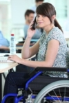 Woman in wheelchair with phone