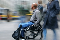 Man in wheelchair in city