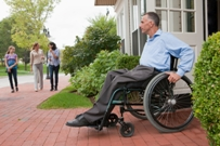 Man in wheelchair at door
