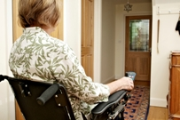 Woman in wheelchair in hallway