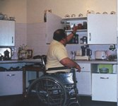 man in wheelchair in kitchen